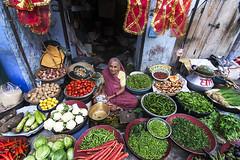 A Vegetable vendor (Rajagopalan Sarangapani) Tags: woman colorful sitting veiled market vegatables