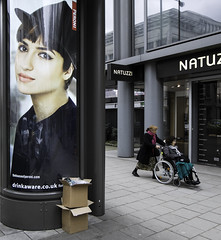NATUZZI (stevedexteruk) Tags: road london westminster wheel court advertising chair box candid wheelchair streetphotography billboard cardboard drinkware tottenham 2014 natuzzi