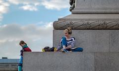 Sitting on Nelsons Column (Fuji X-E1 & XF 56mm Lens) (markdbaynham) Tags: street people urban london westminster square lens prime sitting fuji candid capital central trafalgar evil x nelsons column trans csc f12 xf 56mm x100 apsc fujix mirrorless fujion