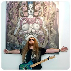 "@scottgailor Jesus Christ posing in front of a huge giclee of my painting ""Katrina Koaster"" original piece is 4x5 ft. Owned by @instaseen"