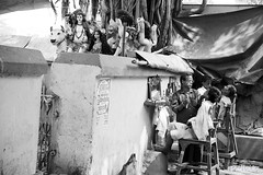 Roadside Barber (pathikdebmallik) Tags: india tree wall streetlife shaving kolkata idols barbers westbengal streetphotographs streetsofkolkata