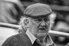 Not a barber lover (Frank Fullard) Tags: frankfullard fullard candid street portrait beard hair cap barber mono blackandwhite ballinasloe fair horsefair galway irish ireland horsedealer farmer country rural