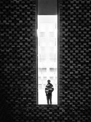 Living in a Box (Feldore) Tags: london tate modern architecture man standing window mono blackandwhite staring looking feldore mchugh em1 olympus 1240mm trapped