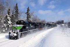 A crossing, then a curve (Michael Berry Railfan) Tags: sfg1819 rs18 mlw montreallocomotiveworks alco train freighttrain windmilltrain gaspesie snow winter sociétéduchemindeferdelagaspésie