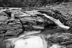 falling (dK.i photography (losing views, thanks panda!)) Tags: longexposure blackandwhite river cloudy maryland overcast hike falls cascades current slippery fallingwater humid savage addictive hss flickrfriday patuxentbranch sliderssunday
