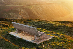 Seat with sunset light (Mikel Martnez de Osaba) Tags: light sunset cliff sunlight beach grass stone sunrise dawn evening twilight chair view dusk seat scene backlit