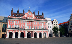 The Rostock City Hall in Rostock Germany (TOTORORO.RORO) Tags: life city travel pink houses light red people white color reflection brick clock tourism window architecture clouds facade shopping germany square lens mirror living europe european day arch artistic market cityhall sony rail tourist clear birthdaycake transit gateway transl