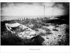 Neglected Mono (Stuart Leche) Tags: blue red sea sky seascape beach overgrown monochrome landscape boats mono coast boat blackwhite kent seaside weeds yacht coastal boating nostalgic leisure vacations whitstable groynes passtimes