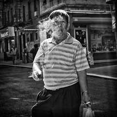 Smoked (Ross Magrath) Tags: china from street camera new york old city nyc summer bw usa cloud white man black hot streets colour face weather contrast digital america wonderful dark photography mono weird town high funny noir shadows gloomy serious pentax no cigarette candid stripes character smoke united north puff sunny humour smoking v elderly shade unknown shooting cropped format imaging gloom gr states hip agus ban drama miserable et blanc ricoh sneaky compact sensor humid smoked dubh apsc