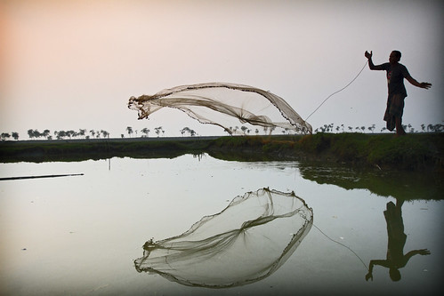 Last throw before the sun sets in Khulna, Bangladesh. Photo by Felix Clay/Duckrabbit, 2013.