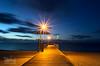 Jetty at twilight (Macrow Photography) Tags: ocean longexposure nightphotography seascape night clouds landscape photography lights twilight sand nikon jetty kitlens australia coastline bluehour starburst nightonearth d7000 flickraward5