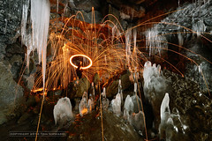 Fire in the Crystal Disco (pdxsafariguy) Tags: winter usa hot cold ice rock underground fire frozen washington burning spinning icicle cave stalagmite sparks troutlake stalactite fiery lavatube icecave steelwool tomschwabel giffordpinchotnationalforest gulericecave