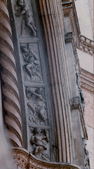 Bologna, Emilia-Romagna, San Petronio, entry, detail (groenling) Tags: italy stone angel italia stonecarving it carving bologna portal angelo tambourine cymbals entry emiliaromagna sanpetronio lyre shawm mmiia