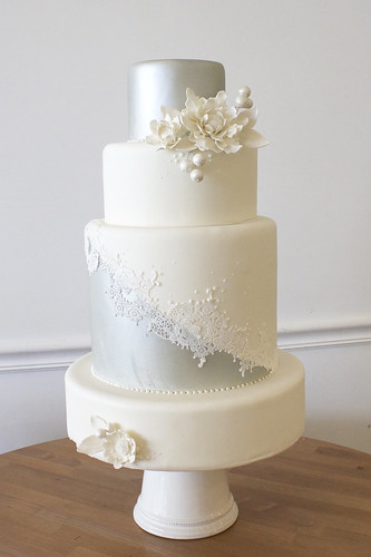 White and Silver Lace Wedding Cake with Sugar Flowers and Berries