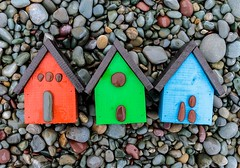 Little Houses (Karen_Chappell) Tags: wood wooden beach paint painted rocks stones pebbles nfld newfoundland birdhouse shed houes rgb red green blue three 3 cute middlecovebeach middlecove atlanticcanada canada avalonpeninsula stilllife
