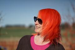 Give us a Twirl (steve_whitmarsh) Tags: niqui garden hair portrait orange pink