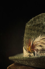 Dad's Hat (borealnz) Tags: old hat lensbaby feather case getty dads suitcase