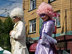 Stiltwalkers (dons projects) Tags: city sun canada sunshine june festival vancouver bc zoom candid sunny streetscene olympus celebration streetperformer performer eastside sonnig sonne commercialdrive zuiko vancouverbc eastvan eastvancouver cityscene evolt thedrive e500 zd fourthirds 1445mm 2013 italianday photoscape seeninvancouver kodakccd donsprojects
