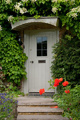 Cotswolds Door (<p&p>) Tags: door uk greatbritain flowers red summer england flower green garden steps entrance cotswolds gloucestershire step poppy poppies gb portal canopy cotswoldhills dwwg