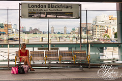 Escape from London (Umbreen Hafeez) Tags: life city uk england woman london station train waiting europe sitting cityscape tube rail gb blackfriars