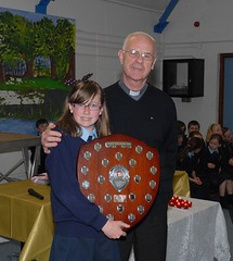 Leah Cummins getting Josephine Doran Citizenship Award from Monsignor Wilson (ballymorebugle) Tags: ireland kildare ballymorebugleballymoreeustace