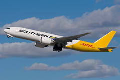 13-376 (George Hamlin) Tags: california photo los airport angeles aircraft air transport cargo southern international airline boeing lax decor takeoff dhl 777f n774sa vision:mountain=075