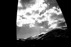 Kodra e Diellit (Lumieres Du Matin) Tags: travel winter light sunlight white snow black mountains cold window nature beautiful canon dark landscape photography grey blackwhite exposure peace place peaceful calm macedonia sunrays cinematic emotions camerabag feelings calmness misterious melancolic shapka popova tetovo 40d popovashapka vision:mountain=07 vision:outdoor=0776 vision:clouds=0843 vision:sky=09