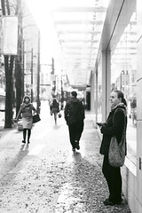 November sunlight (Eric Flexyourhead (Moved in, catching up)) Tags: street city people urban bw sunlight canada vancouver standing walking blackwhite waiting downtown afternoon bc britishcolumbia sidewalk pedestrians 45mm granvillestreet zd mzuikodigital45mmf18 olympusem5