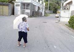 知念 歩くひと Nanjo-si, Okinawa (ymtrx79g ( Activity stop)) Tags: street color slr film japan analog nikon kodak 35mmfilm okinawa 135 沖縄 kodakgold100 傘 街 写真 銀塩 フィルム nikonnewfm2 南城市 nikonaisnikkor28mmf28 歩行走行 walkandrun umbrellaandparasol 201310blog nanjosi
