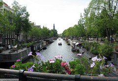 Amsterdam Canal / Amsterdamse Gracht (gerry.bates) Tags: city trees houses urban holland netherlands dutch amsterdam canon boats canal european bridges steeple houseboats oudekerk noordholland gracht residences flowerpots capitalcity woonboot oudesijdsvoorburgwal