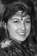 A Maiden's Coy smile (wyojones) Tags: blackandwhite bw woman usa white black tiara cute girl beautiful beauty smile look festival lady pretty texas princess makeup lips trf faire crown grayscale brunette lovely browneyes fest renaissance renfest maiden wench greyscale damsel texasrenaissancefestival toddmission wyojones