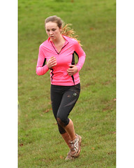 Runner in Pink (Adrian Midgley) Tags: pink concentration hand serious etc cropped runner reworked