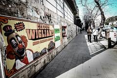 under a clown observation [Technicolor] (Andrea Scire') Tags: street shadow italy strada circo circus andrea clown ombra streetphotography line sicily sicilia uomini passeggiata marciapiede scire scirè andreascire andreascirè ©phandreascire