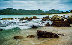 Lazy waves at Wineglass Bay (Shaun Versey) Tags: park mountains beach water bay sand rocks wave national shore tasmania wineglass hazards freycinet the