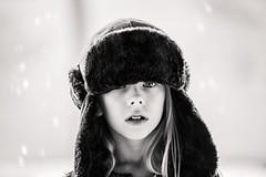"""It keeps my eyebrows warm."" (aamith) Tags: portrait blackandwhite bw bnw monochrome carlziess ziess kids hat 135mm bokeh dof girl"