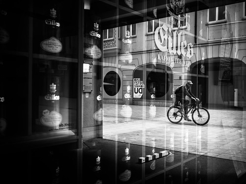 reflections (Sandy...J) Tags: reflection olympus blackwhite bw black bike biker city street streetphotography monochrom man urban white noir