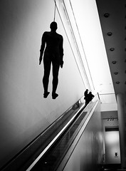 L1000551-Edit (Camera Freak) Tags: sculpture anthonygormley tatebritain lobby hall hanging ceiling monochrome blackandwhite tate tategallery gallery art escalator