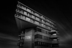 Call the ships to port (blondmao) Tags: fineart building bnw switzerland münchenstein clouds 16stopper longexposure dark transitlager bw apartmenthouse concrete blackandwhite residentialbuilding basel