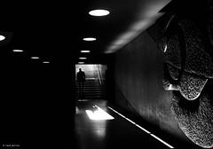 Step into the dark - or out of spring (René Mollet) Tags: spring dark light backlight blackandwhite blackwhite bw monchrom monochromphotographie monochrom aarau mainstation underground man renémollet street streetphotography streetart streetphotographiebw streetphotographie skulpure