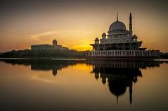 unruffled... (MailHamdi) Tags: sunrise rotatedreflection sun masjidputra mosque icon putrajayalandmark malaysia mailhamdiimages nikon d90 tokina1116 raymaster haidand ray building mirror silhouette