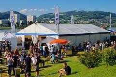 Linzfest 2013 -Tag 1 (austrianpsycho) Tags: people linz leute wiese flags menschen zelt flaggen tische zipfer fahnen bierzelt 2013 linzfest bänke 18052013 linzfest2013