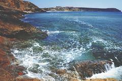 Crash! (icewouldsuffice) Tags: blue red sea sun white green beach portugal digital bay sand rocks waves doubleexposure crest cliffs foam algarve splash breeze multiexposure