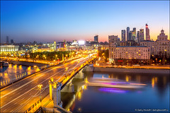 Beautiful night scenery of Moscow (Dmitry Mordolff) Tags: street bridge blue sunset sky house motion blur reflection nature water skyline architecture night skyscraper buildings river outdoors lights town spring downtown cityscape waterfront view place russia dusk moscow district cities landmarks illuminated russian residential embankment scenics locations landscaped