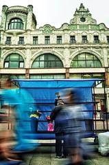 #Art Nouveau Building for #FlickrFriday (GardenPatch) Tags: city flowers blue blur colour building green castle art design nikon strangers belfast artnouveau busy northernireland rushhour challenge citycentre flowerseller passingby flickrfriday castlebuildings d5100