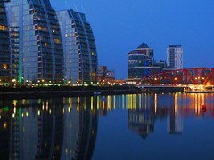 New camera, old view (Claire Wroe) Tags: bridge blue light red sky reflection building water glass yellow architecture modern manchester lights apartment flat basin reflect salford quays huron