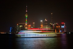Tron Boat Arrives In Shanghai (www.bazpics.com) Tags: show china city cruise blue light red mist building green tower fog skyline skyscraper river boat shanghai chinese tourist led bund attraction