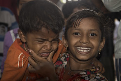 The reluctant star (Photosightfaces) Tags: india smile kids children happy kid sad young laugh grin grinning melancholy mumbai reluctant despondent captivating