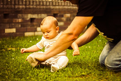 Nature Meets Nature (Julia Schmuck) Tags: portrait people baby nature grass photo holding father curious photograhpy