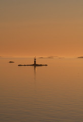 Midnight on the ferry to Kkar (ZeiR) Tags: ocean sunset sea sky orange lighthouse reflection june ferry canon suomi finland island view horizon sigma surface midnight archipelago kkar msgudingen landstrafiken