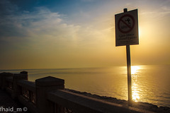 No swimming (fhaid) Tags: ocean sea sun sign danger swimming mark no sidewalk corniche